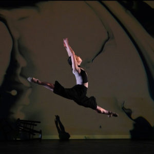 Elizabeth Watson leaping through the air at Atlas Intersections 2020
